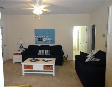 Spacious living group w/ queen & twin sleeper, flat screen TV and wet bar.