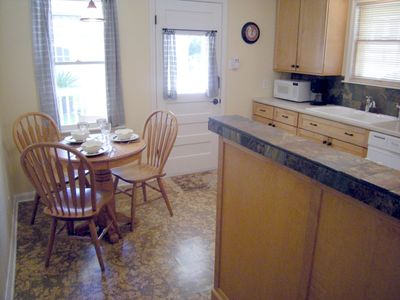 Fully equipped kitchen and a dining nook.