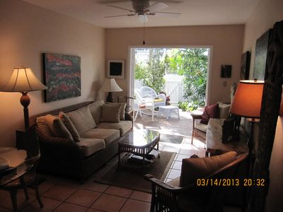 Living Room.  Access to landscaped patio