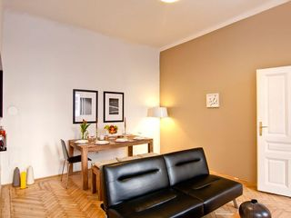Innere Stadt apartment photo - Designer Living-room with a very easy to use and comfortable Couch-bed (110x200)