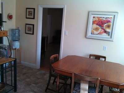Partial view of kitchen/eating area.
