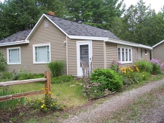 Summer flowers add a natural charm - Interlochen cottage vacation rental photo