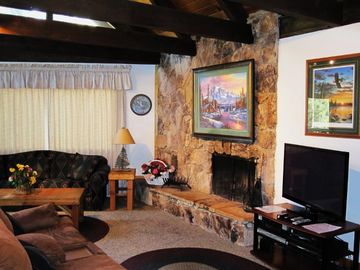 Living Room has open beam ceiling and large HD TV for your enjoyment.
