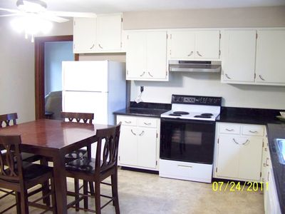 Eatin kitchen with dishwasher, microwave and stove