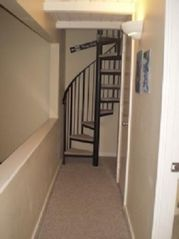 Waterville Valley condo photo - spiral staircase to sleeping loft