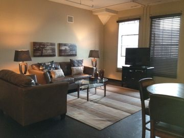 Little Rock apartment rental - Living Room area with concrete flooring
