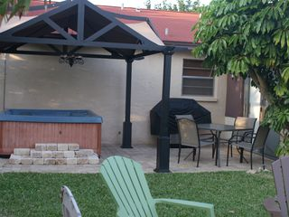 Indialantic house photo - Covered Jacuzzi, Grill & Firepit~All for your enjoyment!