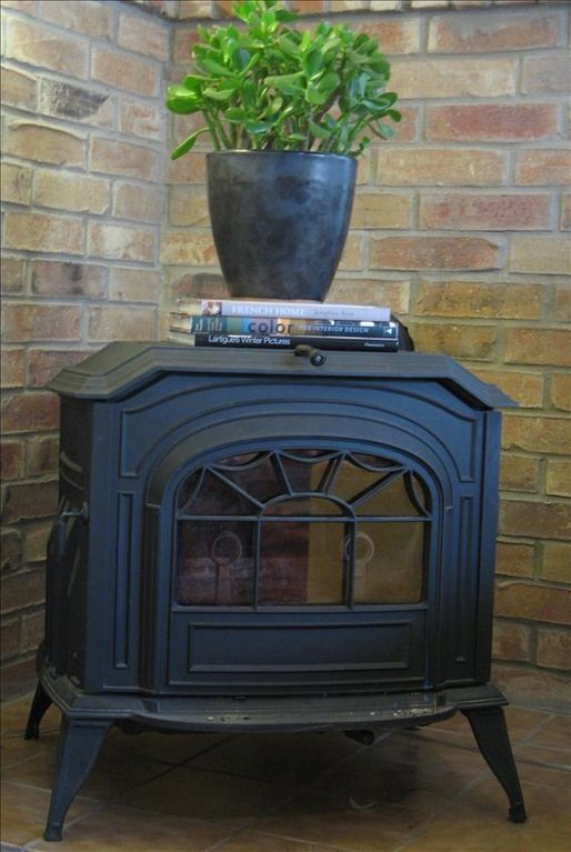 This is a cozy wood burning stove (clean, functional, and warm in Winter).