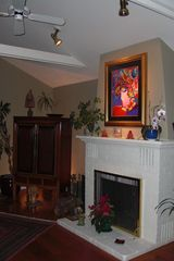 Tiburon house photo - Cozy fireplace and armoire with DirecTV/DVR & DVD player.
