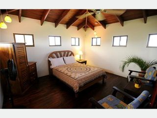 Playa Negra house photo - Loft Bedroom with ocean breezes, lots of light, private seating area.