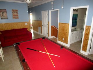 Ocean Drive Beach condo photo - Pool hall style table is newly refelted and loveseat has a pullout double bed.