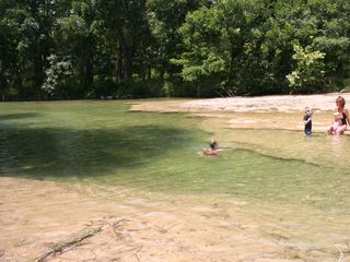 Natural swimming hole in both normal and drought conditions. - Wimberley house vacation rental photo