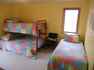 Jacksonport house photo - Parkside Bedroom has a Double Bed, 2 Twins, Dresser and Closet