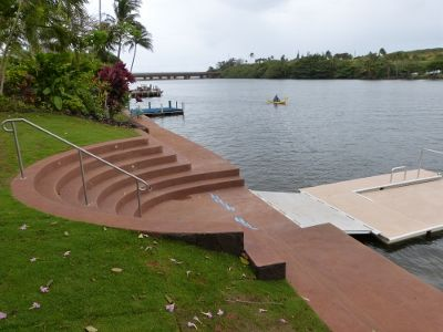 Floating dock with access from circular steps built into the river wall.