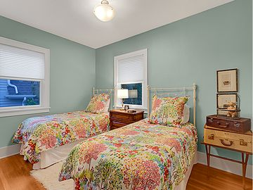 Darling room with twin beds and white wrought iron frames
