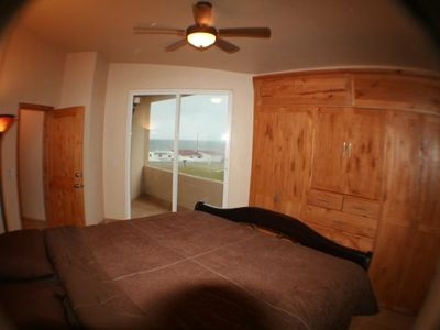 Bedroom 2 with Ocean View, King Bed, Fan, Large Cosets with TV and DVD player.