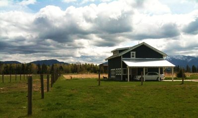 Whitefish bungalow rental - The guesthouse is surrounded by horse pastures.