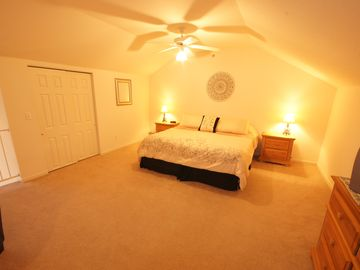 The Spacious Third Bedroom in the Loft includes a comfortable King-Sized Bed