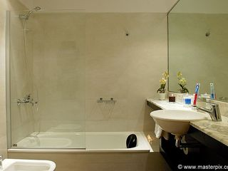 Palermo apartment photo - Bathroom has a full bathtub as well as a shower. It has a toilet and bidet too