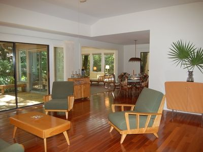 All rooms have large sliding glass doors and hardwood floors.