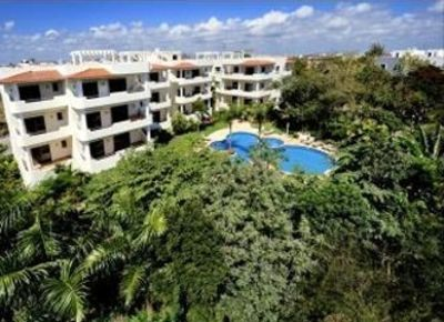 Playa del Carmen condo rental - Palmar del Sol and its green surroundings