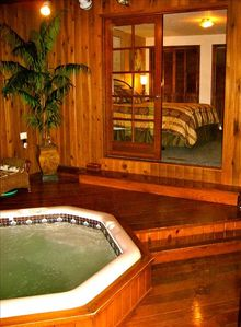 Relax in the indoor hot tub with cedar flooring after a long day at the beach!