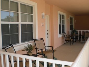 Covered front porch entry to condo