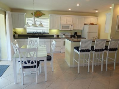 The dining and kitchen areas of our Great Room, adjacent to the front lanai.