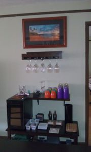 Wine Bar with Wine Cooler and Glassware.  Table games and cards on lower shelf.