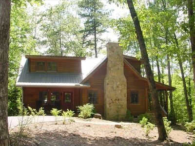 Cabin is surrounded by beautiful hardwoods