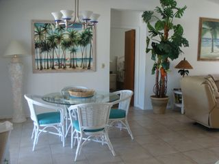 St. Augustine Beach house photo - Lovely dining area with views of pool overlooking the waterway.