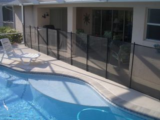 Cape Coral house photo - A baby-proof pool fence sets up in 15 minutes to keep the littlest ones safe