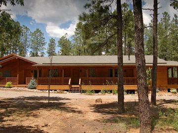 Pinetop cabin rental - Looking at the cabin from the east side showing exterior entrances to 5 bedrooms