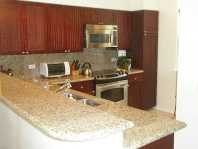 Kitchen with SS appliances, granite counters