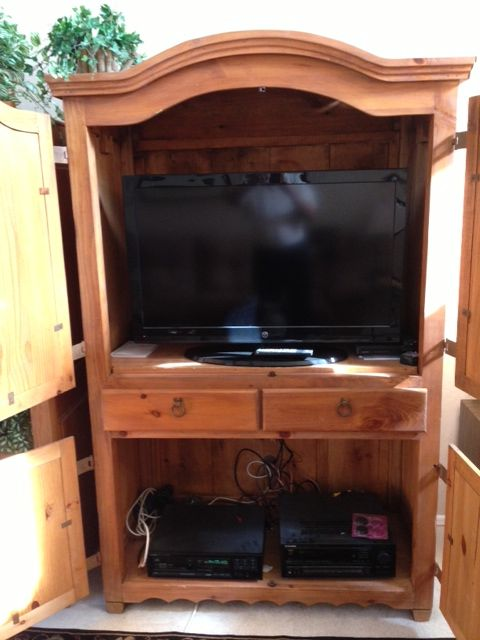 Entertainment center with flat screen TV and stereo