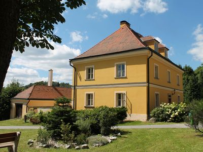 Lovely renovated former parsonage with a romantic enclosed courtyard in Western Bohemia.