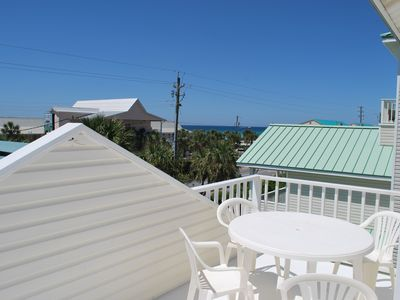 View of the gulf to the west with seating for drinks, games, or dining.