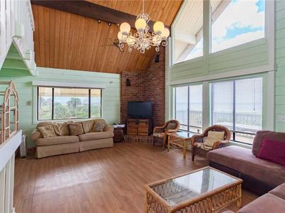 Breathtaking ocean views from this 2nd floor living room - Get the best seat in the house in this open plan living room with comfy rattan furniture.