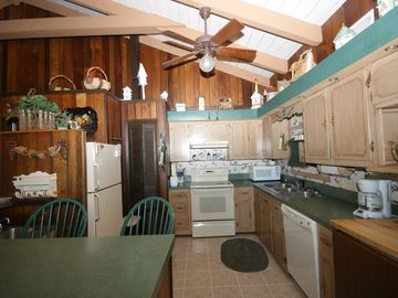 Kitchen will ceiling fan, wood block and large bar-2 sinks