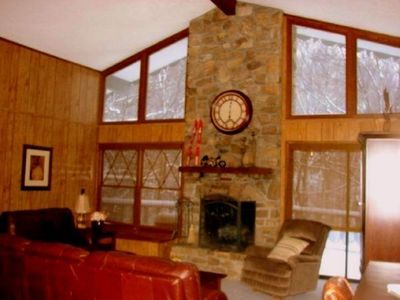 Upstairs with another stone fireplace, another deck, main kitchen 2 brms, 2ba