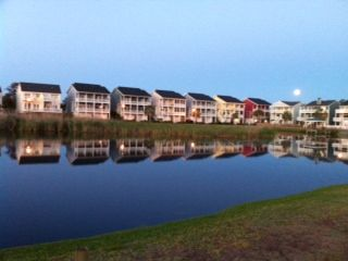 Lake houses at dawn with full moon