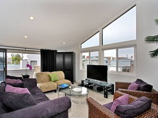 Mission Beach house photo - Ample seating - additional luggage storage for guests in this roomy armoire.
