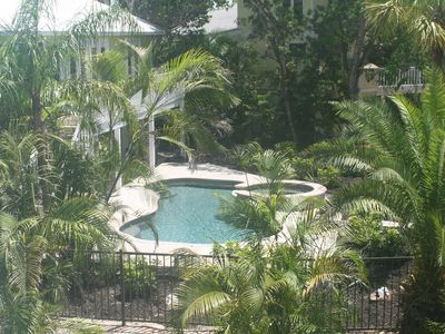 Tropically landscaped yard, heated spa and pool, and second floor deck.