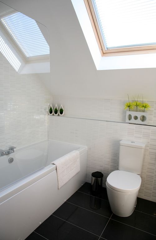 Upstairs family bathroom with overbath shower