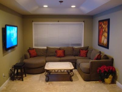 "Family room and home theater with 52"" HDTV and Blu-Ray player"