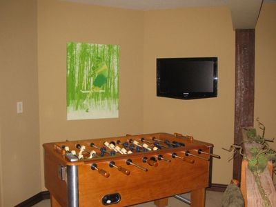 game room with foosball & custom built poker table (not shown)