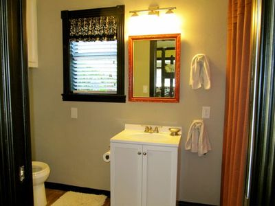 MASTER BATH with beautiful garden view and washer/dryer