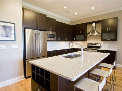 Gourmet Kitchen with stainless steel appliances and breakfast bar