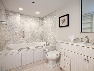 Boston apartment photo - Marble bathroom.