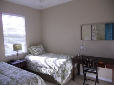 Comfortable, twin beds and a work or craft desk in guest bedroom